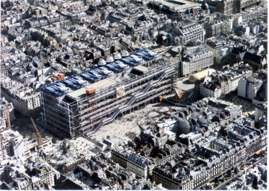 A picture from the top of the square and the Centre Pompidou. On the right, partially in shadow, we observe the Diatope of Xenakis. Paris, 1977.