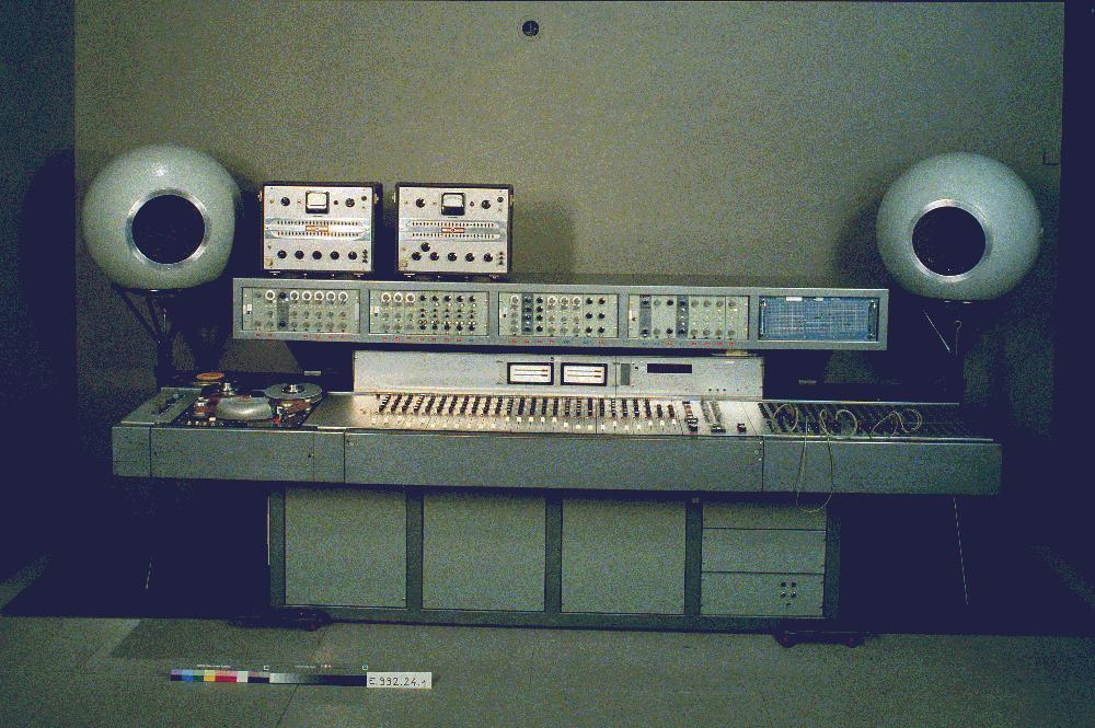 A picture of the GRM in Paris that shows us the mixing desk and the Coupigny synthesizer. Paris, about 1972.