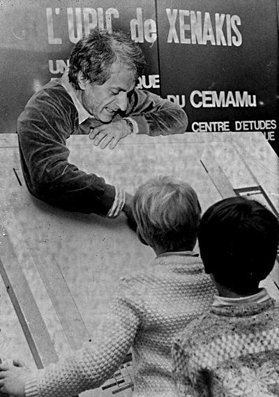 Xenakis shows how the digital whiteboard run, to some children. About 1979. Via Joel Chadabe .