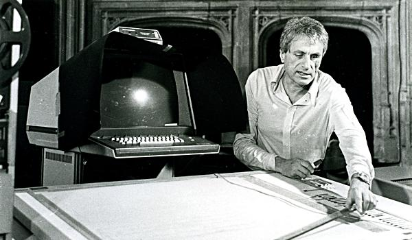 Iannis Xenakis probably while illustrating the operation of the UPIC system, in particular focusing on graphic tablet on which it is bent. The late seventies. Via Joel Chadabe .