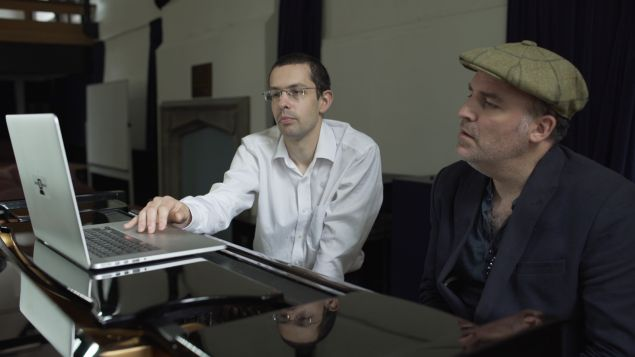 Nick Collins presents the music software Android Lloyd Webber to Benjamin Till, English composer.